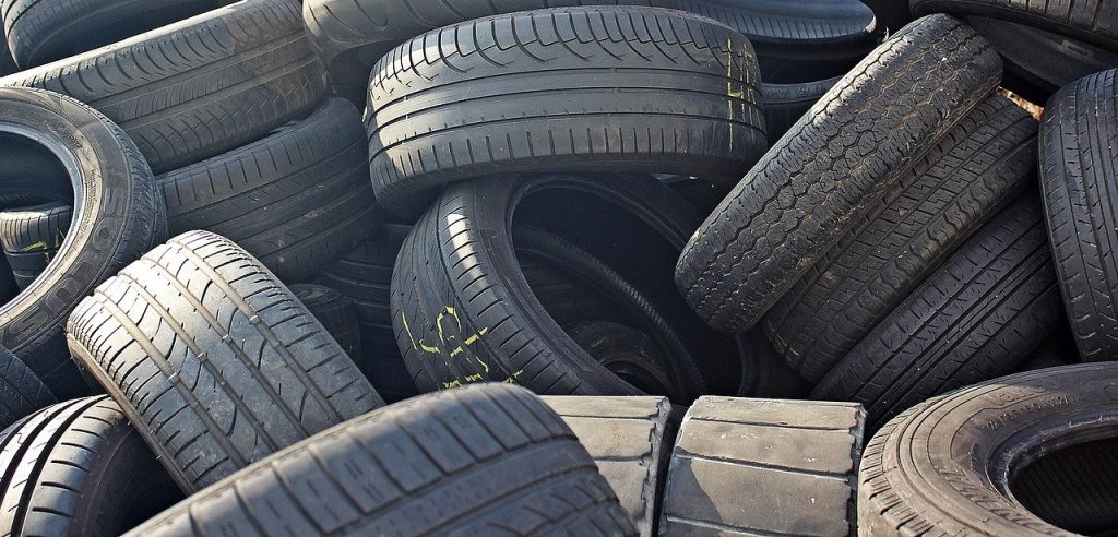 Image of a pile of old car tyres